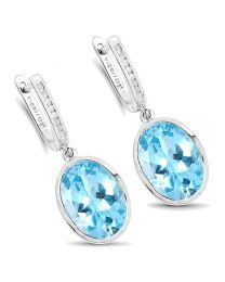 Genuine Round Diamond and Blue Topaz Earrings in Sterling Silver